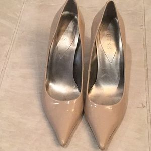 Guess patent leather nude pointy toe heels.